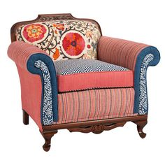 Featuring a carved hardwood frame and multi-print upholstery, this eye-catching arm chair brings a lively pop of style to your sunroom or den.