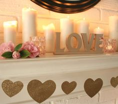 Valentine's Day Mantel |  ❤️️❤️️  Glittery heart garland and lots of tall pillar candles!