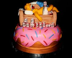 Homer simpson is a bum who loves his Duff beer and doughnuts!! The doughnut is chocolate cake, as well as the bottom section of the couch. Decorations made with fondant