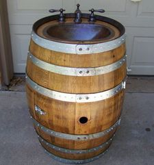 to put in front of spigot by back door and add a door to front of barrel for hose to hide inside while not using. Wine Barrel Sink, Wine Barrel Fire Pit, Kitchen Jars, Kitchen And Bath, Vintage Industrial, Industrial Style, Wine Barrels For Sale, Wine Barrel Furniture, Barrel Projects