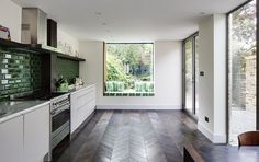 London Fields House - eclectic - Kitchen - London - Brian O'Tuama Architects love green tile and flooring Eclectic Kitchen, New Kitchen, Kitchen Decor, Planchers En Chevrons, Green Tile Backsplash, Green Subway Tile, Subway Tiles, Green Tiles, Chevron Floor