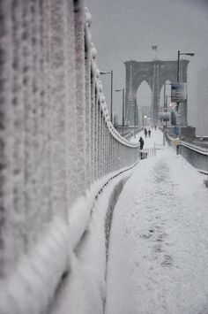 Brooklyn Bridge during Winter Snow fall, NewYork, USA