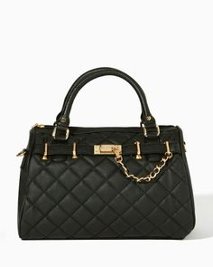 Posh and slightly preppy, this faux leather satchel is quilted on one side. Rolled double handles and a detachable crossbody strap. Zipper top closure. Features a braided chain strap with a clip for keys.