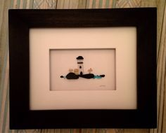 8 x 10 Coast Scene, Sea Glass and pebble art picture by pebble artist, Jodi Bolger. Visit my webpage at www.pebbleartbyjodi.com AND follow me www.instagram.com/pebbleartbyjodi #pebbleart #pebbleartpictures #pebbleartbyjodi #pebbleartbyjodibolger #frommyhearttoyourwall #coastal #lighthouse