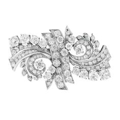 Platinum and Diamond Double Clip-Brooch  The stylized ribbon motif set throughout with 100 old-mine and old European-cut diamonds approximately 9.15 cts., circa 1935, approximately 19 dwt.