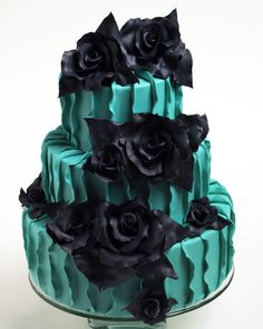 Teal and black ruffles and roses.