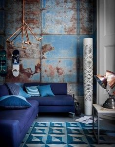 I love the mixture of blues in this room, and the contrast between the beaten looking walls and the crisp textiles.