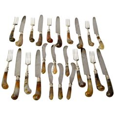 English Set of 18 Agate Handled Knives and Forks Together with Six Fruit Knives | From a unique collection of antique and modern sterling silver at https://www.1stdibs.com/furniture/dining-entertaining/sterling-silver/