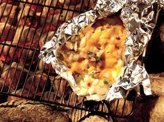Grilled Cheesy Potato Packet, 4 cups frozen potatoes O'Brien with onions and peppers (from 24-oz bag), 1 tablespoon vegetable oil, 1/2 teaspoon seasoned salt, 3/4 cup shredded Cheddar cheese (3 oz)