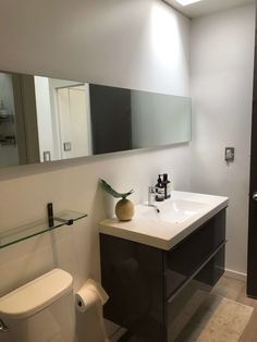 This wide, horizontal slab mirror in small bathroom as seen on Dwell on Design home tours expands the space. Spanish Style Bathrooms, Spanish Style Homes, Spanish Bathroom, Modern Bathroom, Small Bathroom, Glass Front Refrigerator, Brushed Nickel Mirror, Outdoor Living Patios, Indoor Outdoor