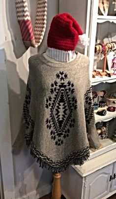 Aztec Sweater Poncho - Stay warm and cozy under this Navy and Gray Aztec patterned Poncho.  Available in Small, Medium and Large. - $64.00