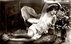 Early Pictures: Nude reclining with flowers, French postcard 1920's