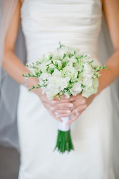 A fresh, white bouquet: http://www.stylemepretty.com/2016/06/20/steal-the-look-morgan-stewarts-glam-all-white-wedding/