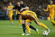 Barcelona's Uruguayan forward Luis Suarez (Down) vies with Atletico Madrid's Uruguayan defender Diego Godin during the UEFA Champions League quarter finals first leg football match FC Barcelona vs Atletico de Madrid at the Camp Nou stadium in Barcelona on April 5, 2016.