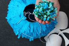 Have guest pull the string to reveal by the color of confetti