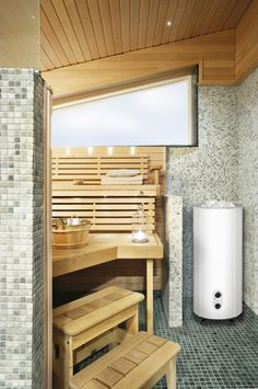White Sumu is the foacalpoint of this sauna where all the walls are Tulikivi's natural stone mosaics. Tulikivi's media