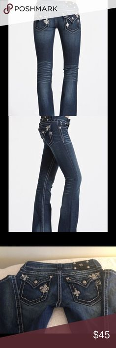 """Miss me Size 28 Jeans JP5369B Boot Cut Jeans Miss me Size 28 Jeans JP5369B Boot Cut Jeans w/fleur de Lis & Small Cross on each pocket, see pics. Back flap pockets, feathered & manufactured distressing on the front and back of the jean bottom leg front & rear.These jeans hug your shape to show off your curves and have a very unique design. They include two small fleur de lis with rhinestones. Medium washed. Inseam 33-1/2"""", leg/hem opening 8-3/4"""", front rise 7"""" Miss Me Jeans Boot Cut"""