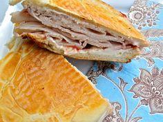 How to make an Elena Ruz Sandwich  (Cuban Turkey Sandwich)  - Ingredients    Cuban sweet sandwich rolls or any other sweet rolls  Turkey breast  Cream cheese, softened  Strawberry preserves