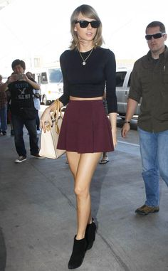 Marooned from Taylor Swift's Street Style  True, this look is a little more fall fashion than summer style. But who cares? Tay's black crop top and maroon skirt pairing is flawless!