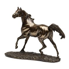 A cold cast bronze replica of a stallion. Cast by hand in Ireland by Genesis Fine Arts.
