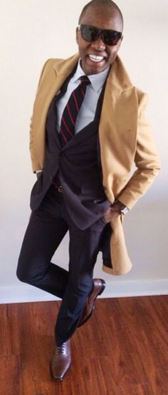 """This above all,          to thine own soul be true.""  Pinstripe Suit - @Ermenegildo Zegna   Color Stripe Tie - @Brooks Brothers  Dress Shirt - @SandroParis  Cotton Pocket Square - @Calvin Klein   Flower Lapel - @hook + ALBERT   Skinny Belt - @J.Crew  Plain Toe Oxfords - @HUGO BOSS  Camel Topcoat - @OfficialZara   Watch - @TtissotOfficial"