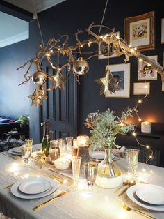 Create the perfect festive party styling for Christmas and New Year's Eve with this DIY hanging branch centrepiece and table setting featuring burnished brass, mixed metallics, faux sheepskin and candlelight Hygge Christmas, Scandi Christmas, Christmas Interiors, Christmas And New Year, Christmas Home, Xmas, Purple Christmas, Coastal Christmas, Modern Christmas