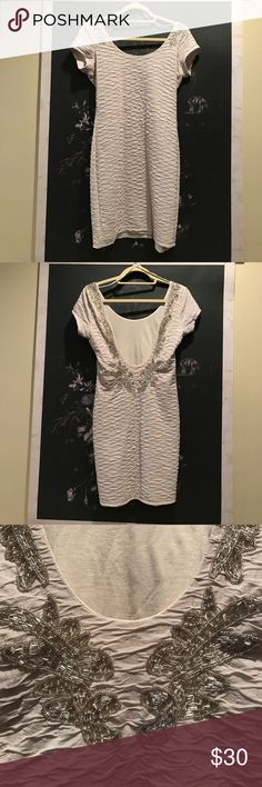 Free People Low Back Beaded Dress - Size Small NWOT never worn. Free people off white dress with low back and beaded detail. Free People Dresses