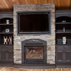 Built in Cabinetry around fireplace by Elmwood Fine Custom Cabinetry