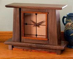 Walnut mantel clock with cherry face and ebony, cocobolo, and walnut insets, by CreamCity Clockworks.