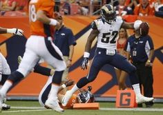 linebacker Alec Ogletree returns a fumble for a touchdown during the first half against the Denver Broncos preseason 2013
