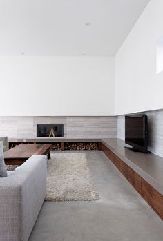 Modern fireplace Sustainable Home Surrounded by a Privileged Natural Setting