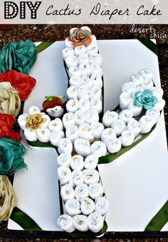a Cactus Diaper Cake with Baby Diapers Need a unique diaper cake idea? Check out this how to make a Cactus Diaper Cake TutorialNeed a unique diaper cake idea? Check out this how to make a Cactus Diaper Cake Tutorial Fiesta Baby Shower, Baby Shower Fun, Baby Shower Gender Reveal, Baby Shower Parties, Baby Shower Themes, Baby Boy Shower, Baby Shower Decorations, Baby Shower Gifts, Shower Ideas