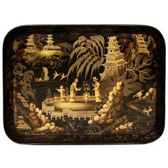 England  Circa 1825  A good Regency papier mache tray in the Chinoserie taste, decorated with robed figures in a garden setting.