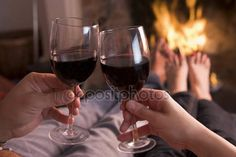 Download - Feet warming at fireplace with hands holding wine — Stock Image #4771639
