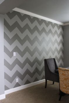 DIY chevron wall. We found it was easier to use a piece of cardboard cut to the measurements we wanted, then slide it across the wall and mark it at each corner to create a grid. We then used the tape to connect the dots on the grid.