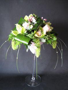 Champagne Glass Flower Arrangement   Share on Twitter