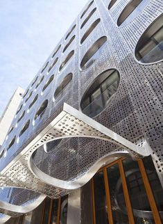 the facade of the dream downtown hotel by handel architects is the perfect balance of sculpture and geometry
