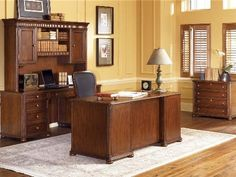 Wynwood Camden Collection a relaxed, transitional home office collection in cherry veneers and rich and medium toned ginger cherry finish. Defined by such classic design elements moldings, framed drawer and door fronts, rounded corners and bun feet, this group provides the right balance for a casual yet sophisticated home office. [$0.00]