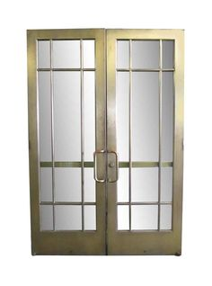 Solid brass doors with 9 lites, original door handles and a push bar. These doors are from the turn of the century from […]