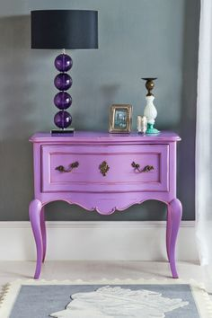 Purple French Bedside Table from OutThereInteriors.com Photo for our new look website (launching soon)! Product available now. Purple Bedside Chest, Purple Glass Table Lamp, Glass and Brass candlestick, Grey Stamp Rug
