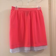 Neon Coral Skirt Perfect for spring/summer! Skirt is a subtle neon coral with grey at the bottom. Slightly see though so a slip would be a smart idea. Mossimo Supply Co Skirts Mini