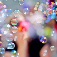 Bokeh + bubbles, just add a little glitter and confetti and it might be perfect.