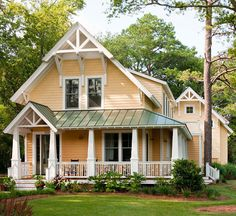 Cheery yellow siding creates a welcoming exterior for this cottage home. More ways to add curb appeal: http://www.bhg.com/home-improvement/exteriors/curb-appeal/ways-to-add-curb-appeal/?socsrc=bhgpin051013yellowsiding=16