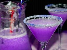 Looks like a KSU martini! Purple Martini 3 oz Vodka 1 oz cranberry juice ½ oz blue Curacao liqueur ½ oz sweet and sour mix ½ of soda Pour the ingredients into a cocktail shaker and shake gently. Add more blue Curacao if the color isn't purple enough. Cocktails Vodka, Cocktail Drinks, Fun Drinks, Yummy Drinks, Cocktail Recipes, Cocktail Shaker, Martinis, Drink Recipes, Purple Cocktails