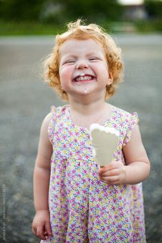 Little girl eats icecream by Jelena Jojic