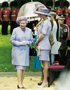 """TheQueenandDianaat the CanadianWar Memorial, London, 1994.    It's unusual for royals to wear the same colour because aides are supposed to liaise about this.  But on this occasion, both Diana and the Queen turned up in the same colour outfit – but they actually looked amused about it.  Diana then said to me later on: """"I had no idea what the Queen was going to be wearing today. I was a bit embarrassed."""" -KentGrant, photographer."""