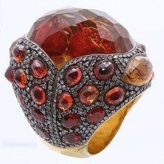 Sevan Bicakci Pomegranate ring, the pomegranates are carved intaglio into the back of the stone.