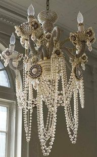 For the DIY .... use a piece like this over the Bride and Groom table in a wedding tent... Find an old chandelier - and dress it up however you fancy, with vintage jewelry and outfit it with LED lights (battery operated)