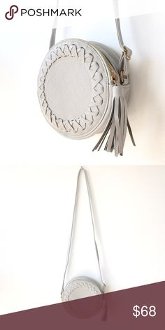 Circle Crossbody Clutch with Long Strap and Tassel Love this long crossbody bag. Has a super cute tassel zipper pull with an adjustable strap. Such an easy color to match. Brand new never used! Listed as Zara since it's a similar look but this was purchased in NYC at a boutique called Pookie & Sebastian Zara Bags Crossbody Bags
