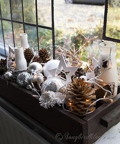 Illuminated and beautiful easy Christmas decoration in silver, white and brown with natural elements. http://www.songbirdblog.com